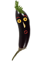Funny portrait made of eggplant  and fruits