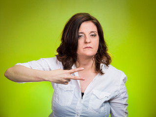 Cut it out all nonsense. Upset angry woman, green background