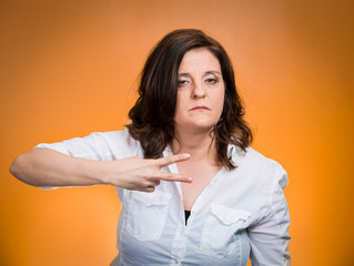 Cut it out all nonsense. Upset angry woman, orange background