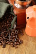 Still life coffee beans in a bag and coffee pot