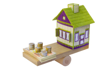 Embroidered house with euro money in balance