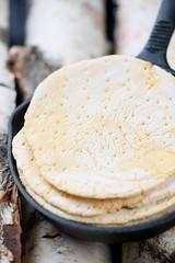 Frying pan with corn tortillas, close-up
