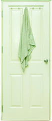 Green towel hang on a white wooden door