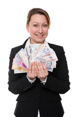 Businesswoman is holding diverse currencies