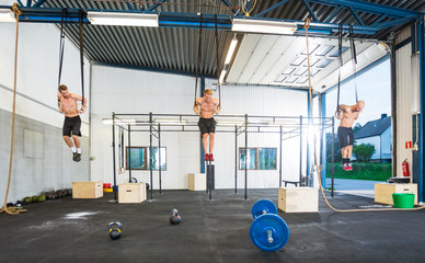 Athletes Hanging On Gymnastic Rings