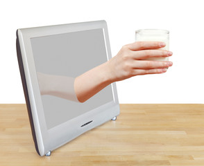 hand holding glass of milk leans out TV screen