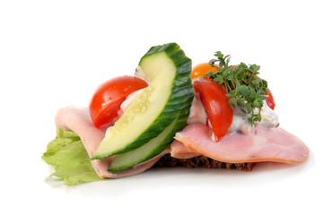 Danish open sandwich with ham, italian salad and cress.
