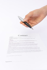 Hand offering pen for signature on contract