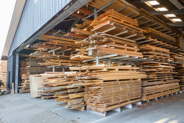 Piles of wooden planks in barn