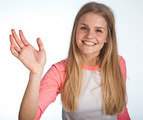 Scandinavian cute young girl waving with her hand