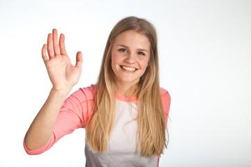 Scandinavian cute young girl waving with her hand