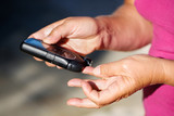 Measuring blood sugar - 70552732