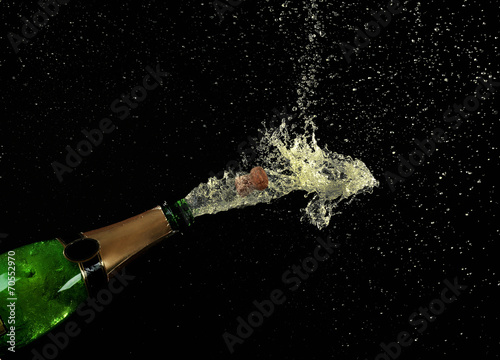 canvas print picture Champagne splashes on black background