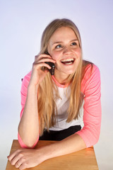 Scandinavian cute young girl talking on the phone
