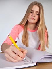 Scandinavian cute young girl writting