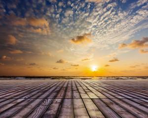 Wooden surface under sunset sky