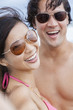 Asian Couple at Beach Taking Selfie Photograph