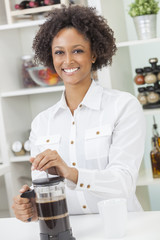 Mixed Race African American Girl Making Coffee