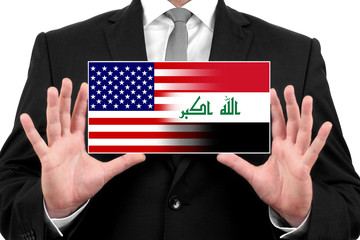 Businessman holding a business card with USA and Iraq Flag