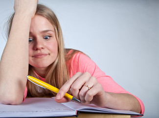 Bored scandinavian cute young girl looking for inspiration  when