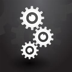 Three white gears on black background
