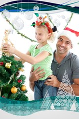 Father helping his daughter to put an angel on the tree