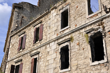 Fragments of partly destroyed building