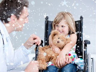 Smiling little girl sitting on the wheelchair