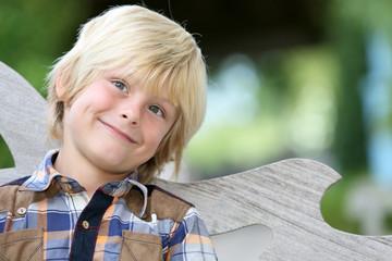 Portrait of sweet blond 7-year-old boy
