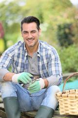 Portrait of smiling man in vegetable garden