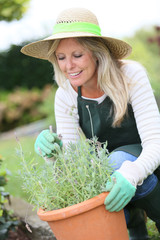 Portrait of beautiful woman gradening aromatic plants