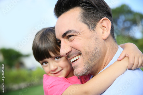 canvas print picture Portrait of little girl hugging her daddy