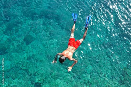 Man snorkeling in the sea - 70558706