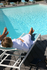 Couple in luxury spa hotel relaxing by pool