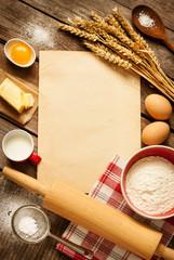 Rural kitchen baking cake ingredients and blank paper