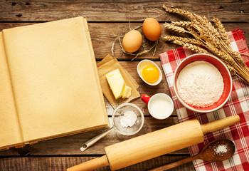 Rural kitchen baking cake ingredients and blank cook book