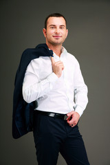 Portrait of a businessman holding his jacket over shoulder