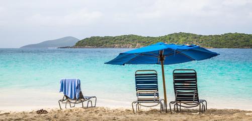 Two Chairs Under Blue Beach Umbrella
