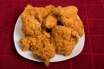White Plate of Fried Chicken on Red Towel