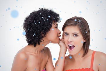 Teenage girl telling a surprising secret to a friend