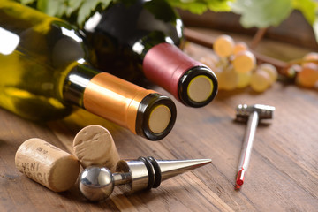 Stopper  with wine corks and bottles of wine on wooden