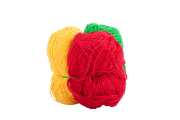 Green yellow red skeins of wool isolated on a white background