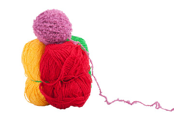 Green yellow red and purple skeins of wool isolated on a white b