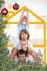 Composite image of family having fun with yellow drawing house