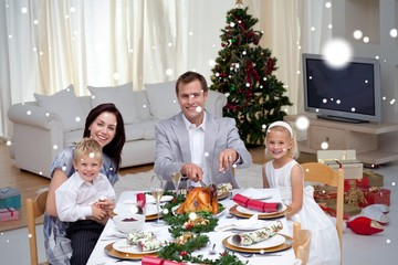 Family celebrating christmas dinner with turkey