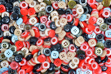Closeup of a pile of buttons of many colors