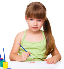 Cute thoughtful child play with paints