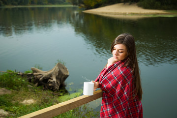 The girl in the morning by the river