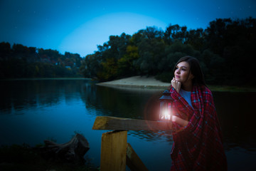 Girl with an old lantern