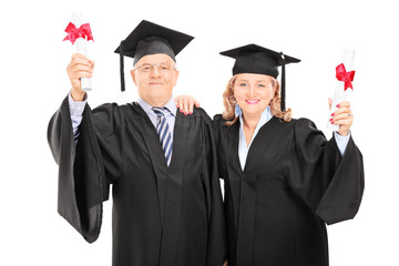 Mature couple celebrating their diplomas